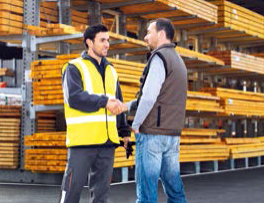 Employee and customer in warehouse