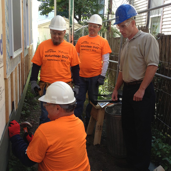Saint-Gobain employees volunteer at a community outreach project
