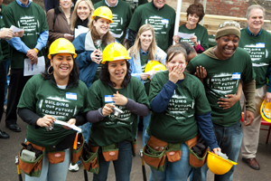 Saint-Gobain employee volunteers with YouthBuild students